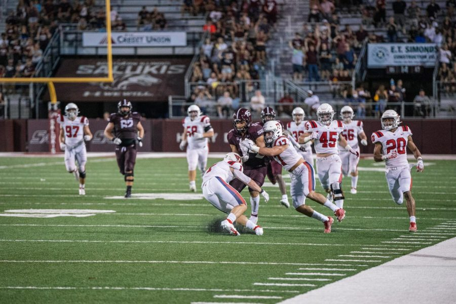 Javon Williams Jr., running back, pushes through the Flyers defenses Sept. 18, 2021 at Saluki Stadium in Carbondale, Ill. Following this play, Jerron Rollins scored a touchdown making the score 31-0.