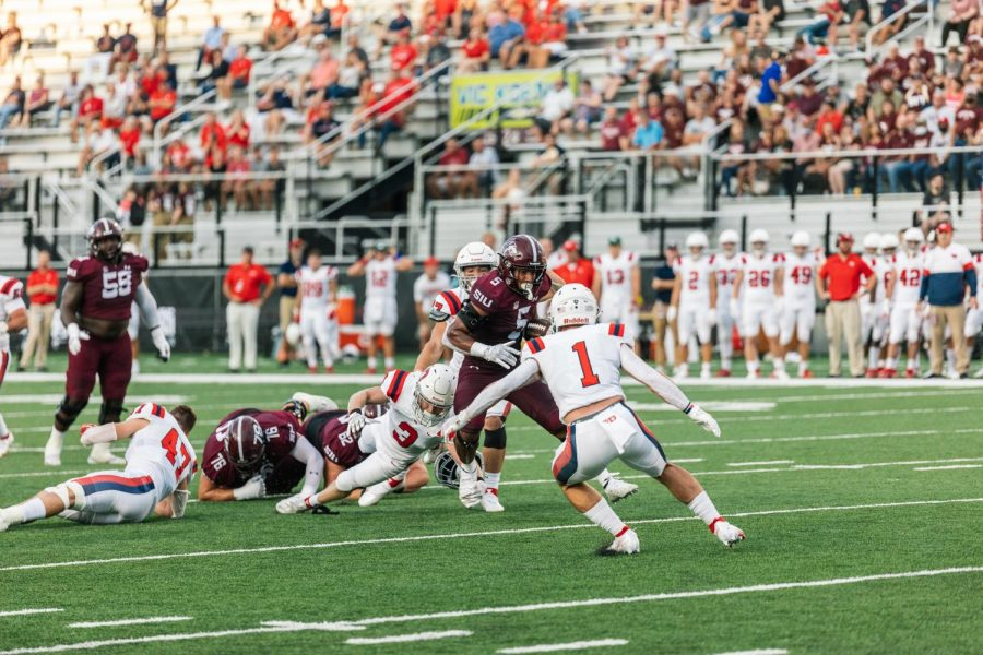 Justin Strong rushes past Daytons defenses Sept. 18, 2021 at Saluki Stadium in Carbondale, Ill.
