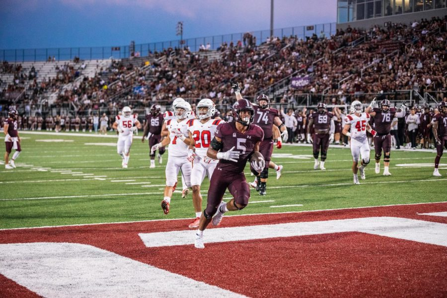 Justin Strong runs to the end zone for a 12 yard touchdown Sept. 18, 2021 at Saluki Stadium in Carbondale, Ill. The Salukis defeated the Dayton Flyers 55-3 in Saturdays game.