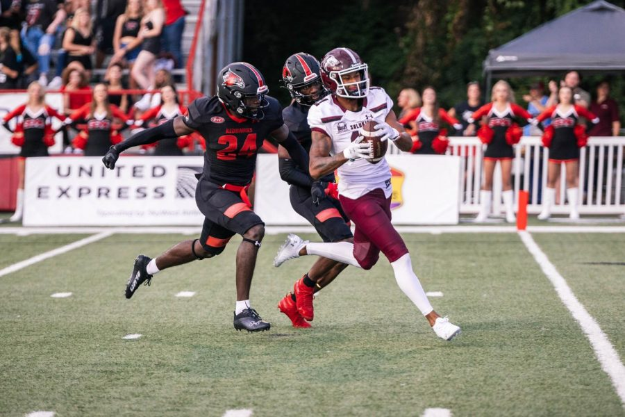 Avante Cox (11) receives a ninety-nine yard pass from Nic Baker (8) to score the first touchdown in a game against Southeast Missouri State University Sept. 2, 2021 at Houck Stadium in Cape Girardeau, Mo.