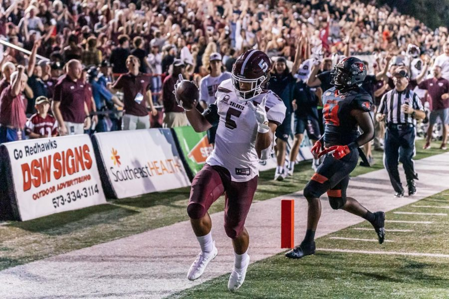 Justin Strong (5) runs the ball into the end zone to score for the Salukis in a game against Southeast Missouri State University Sept. 2, 2021 at Houck Stadium in Cape Girardeau, Mo. Strongs touchdown put the Salukis ahead of the Redhawks, 28-7.