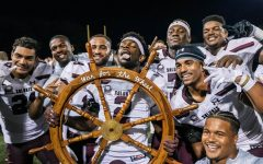 James Ceasar (2) holds the wheel with his teammates after defeating Southeast Missouri State University 47-21 Sept. 2, 2021 at Houck Stadium in Cape Girardeau, Mo.
