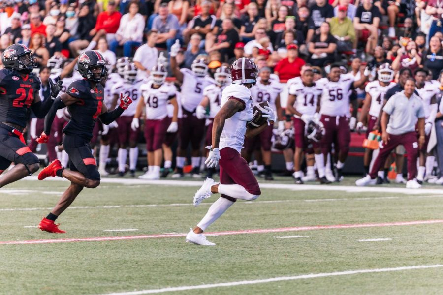 Avante Cox (11) looks back at Southeastern Missouri State Universitys defense before scoring a touchdown Sept. 2, 2021 at Houck Stadium in Cape Girardeau, Mo.
