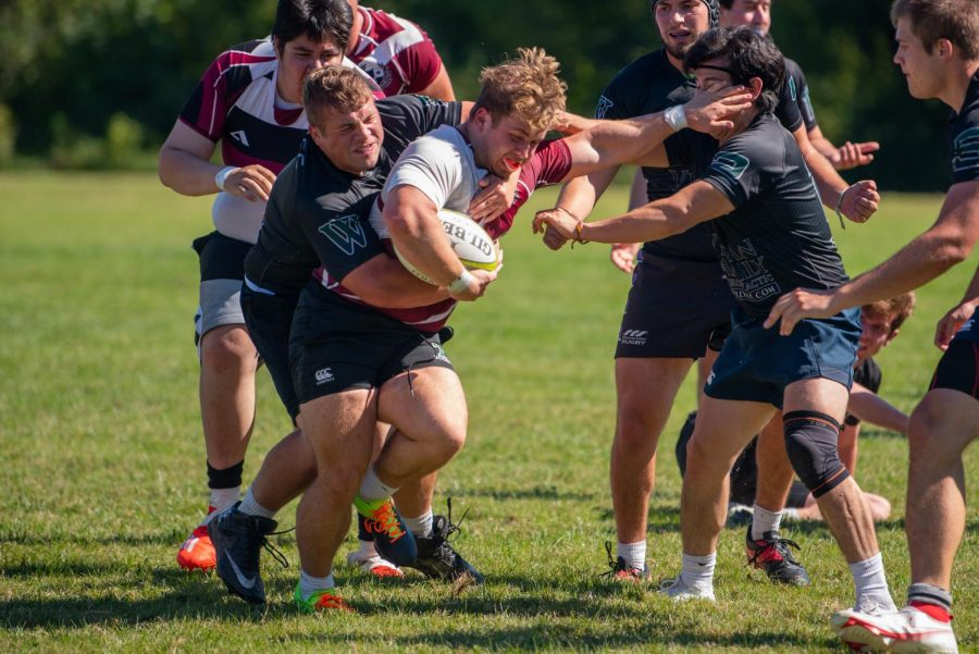 Jackson Hall fights off a few Griffin backs during the match against Washington University on Saturday, Sept. 25, 2021 at SIU
