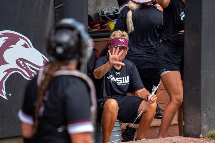SIU head coach, Kerri Blaylock, gives a sign to SIUs catcher during the second game of the doubleheader vs. Three River Community College. The Salukis would win both games on Sunday, Sept. 19, 2021 at the Charlotte West Stadium in Carbondale, Illinois.