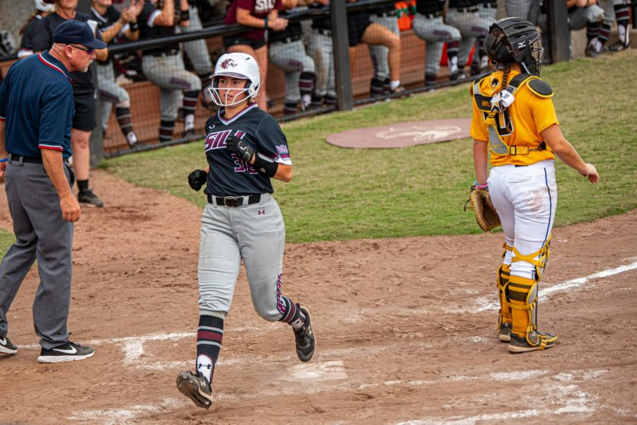 SIU infielder, Elisabeth Huckleberry, trots in for the scoring run during the second game of the doubleheader vs. Three River Community College. The Salukis would win both games on Sunday, Sept. 19, 2021 at the Charlotte West Stadium in Carbondale, Illinois.