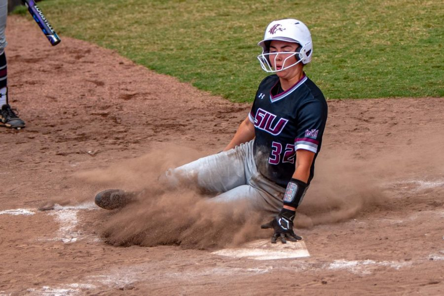 SIU infielder, Elisabeth Huckleberry, slides in for the scoring run as the ball comes to the plate during the second game of the doubleheader vs. Three River Community College. The Salukis would win both games on Sunday, Sept. 19, 2021 at the Charlotte West Stadium in Carbondale, Illinois.