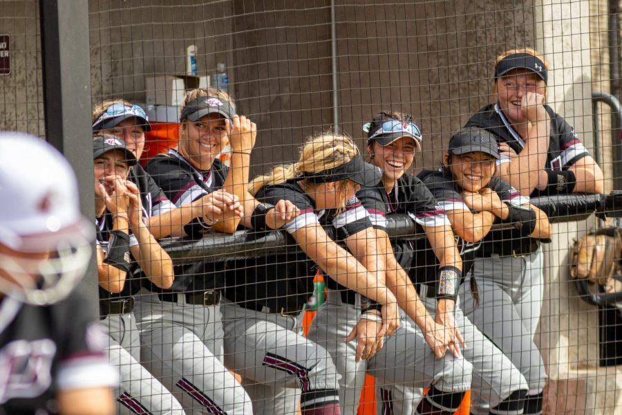 The SIU bench smile and cheer during the first game of the doubleheader vs. Three River Community College. The Salukis would win both games on Sunday, Sept. 19, 2021 at the Charlotte West Stadium in Carbondale, Illinois.