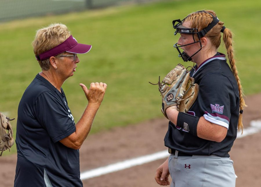 SIU softball head coach Kerri Blaylock, left, gives a talk to pitcher Alexis Rudd during the second game of the doubleheader vs. Three River Community College. The Salukis would win both games on Sunday, Sept. 19, 2021 at the Charlotte West Stadium in Carbondale, Illinois.