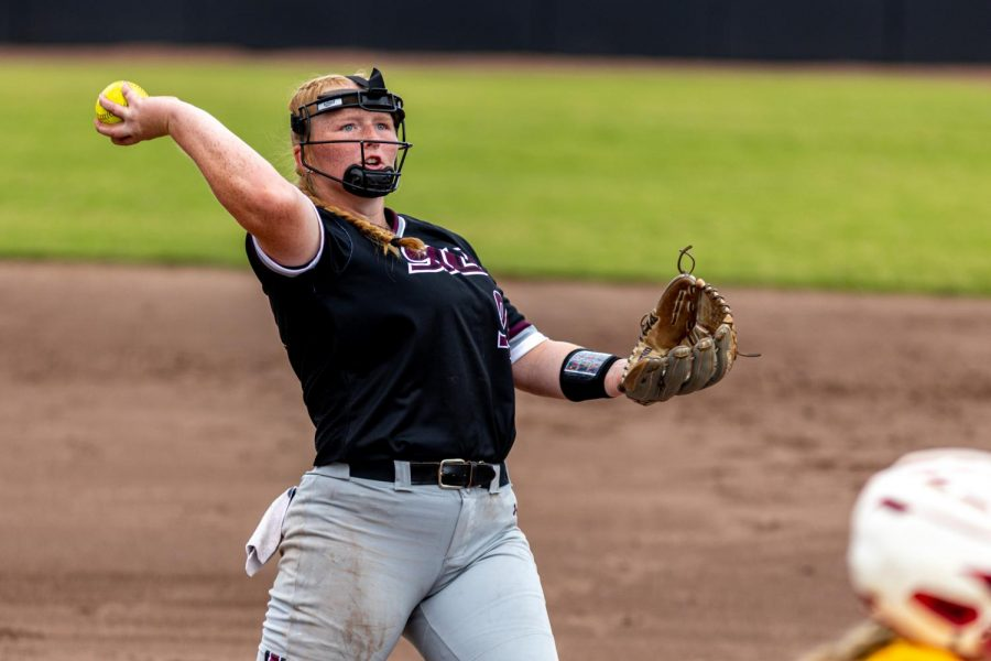 SIU pitcher, Alexis Rudd, throws the ball to first base for the out after a bunt attempt from a Raiders player during the second game of the doubleheader vs. Three River Community College. The Salukis would win both games on Sunday, Sept. 19, 2021 at the Charlotte West Stadium in Carbondale, Illinois.