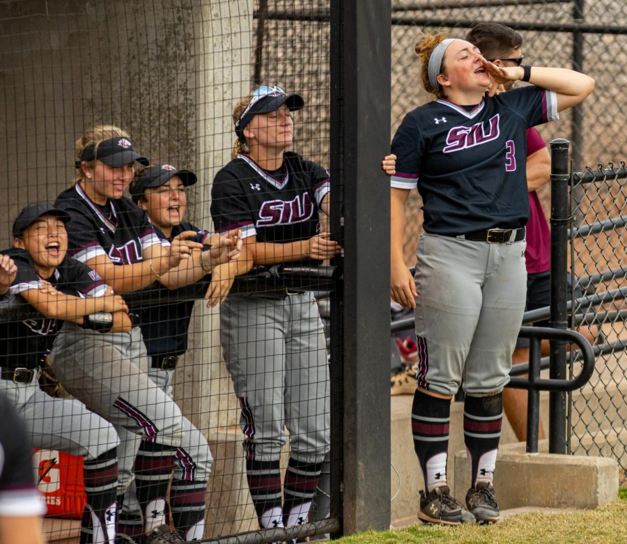 Madi Eberle leads the SIU bench in a cheer  during the second game of the doubleheader vs. Three River Community College. The Salukis would win both games on Sunday, Sept. 19, 2021 at the Charlotte West Stadium in Carbondale, Illinois.