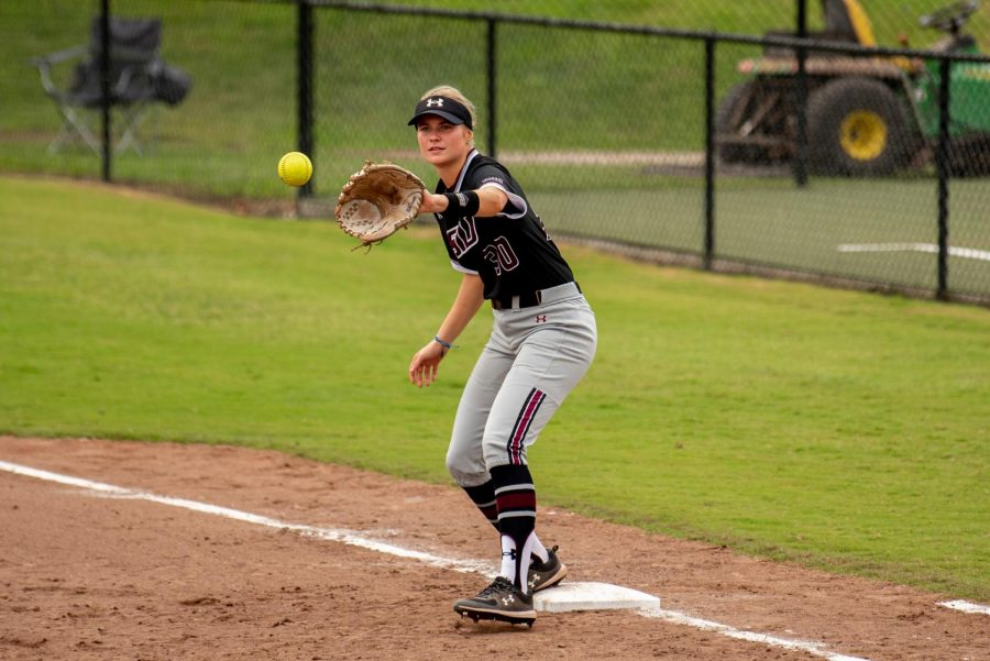 SIU first basemen, Addi Baker, gets the ball for the out  during the first game of the doubleheader vs. Three River Community College. The Salukis would win both games on Sunday, Sept. 19, 2021 at the Charlotte West Stadium in Carbondale, Illinois.