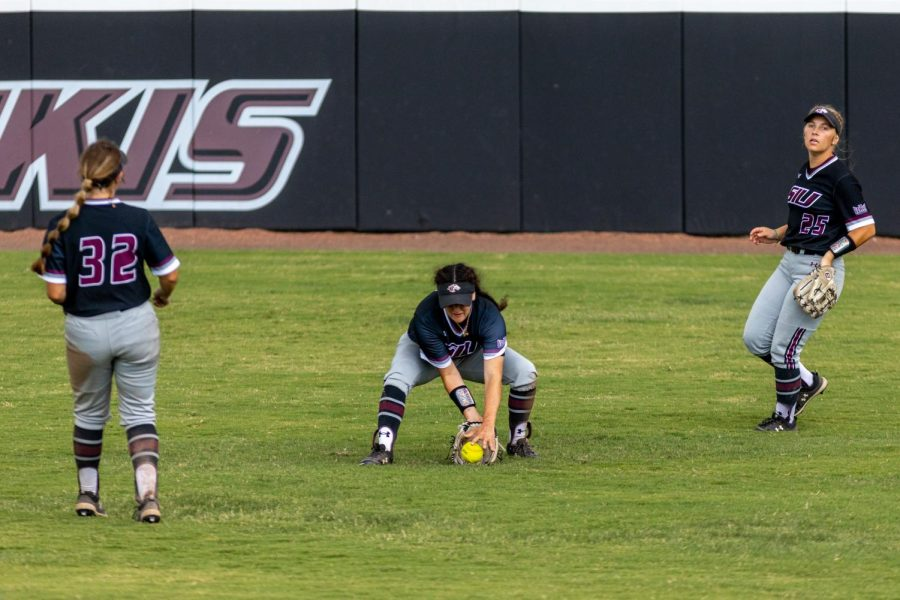 SIU outfielder, Elizabeth Warwick, grounds a ball after it gets hit into shallow center during the second game of the doubleheader vs. Three River Community College. The Salukis would win both games on Sunday, Sept. 19, 2021 at the Charlotte West Stadium in Carbondale, Illinois.