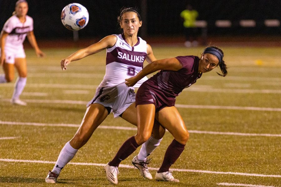 SIU forward, Liz Brechtel, watches as she passes the ball while being defended by a MSU player during SIUs first conference game against Missouri State. The bears would go onto to beat out the Salukis 3-0 on Friday, Sept. 17, 2021 at Lew Hartzog Track and Field Complex at SIU.