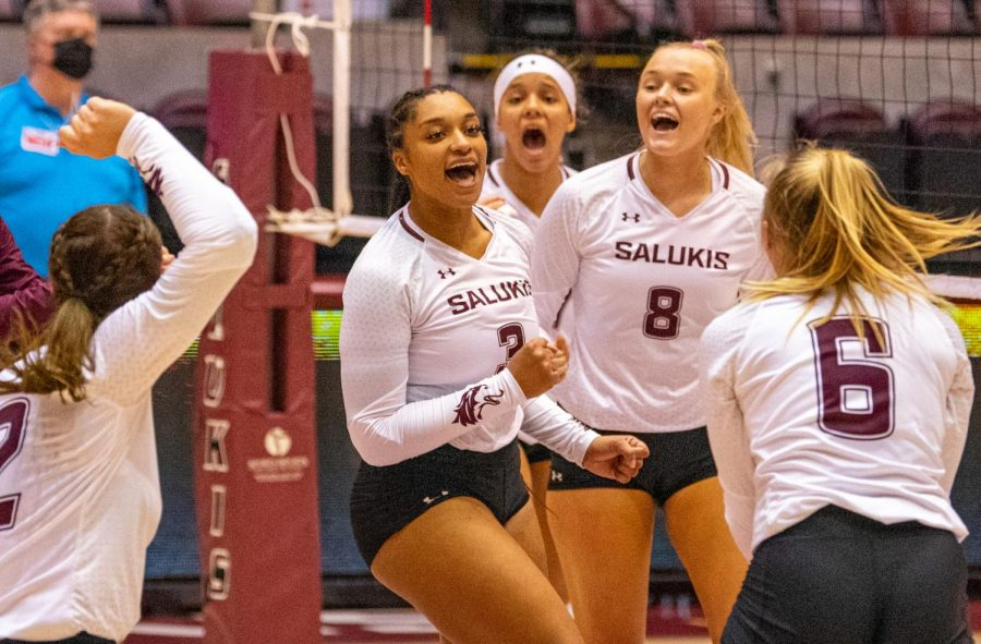 The team reacts to Alex Washington, middle, as she comes up with a score for SIU vs. EIU. SIU would later on drop their early 2-0 lead and fall to EIU 3-2 on Friday, Sept. 10, 2021 during the Saluki Invitational at the Banterra Center at SIU.