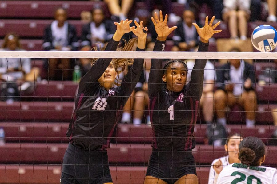 Margherita Giani, left, goes up with fellow teammate Nsia Gittens, right, for block attempt during the Salukis 3-0 win over the University of South Carolina - Upstate on Friday, Sept. 10, 2021 during the Saluki Invitational at the Banterra Center at SIU.