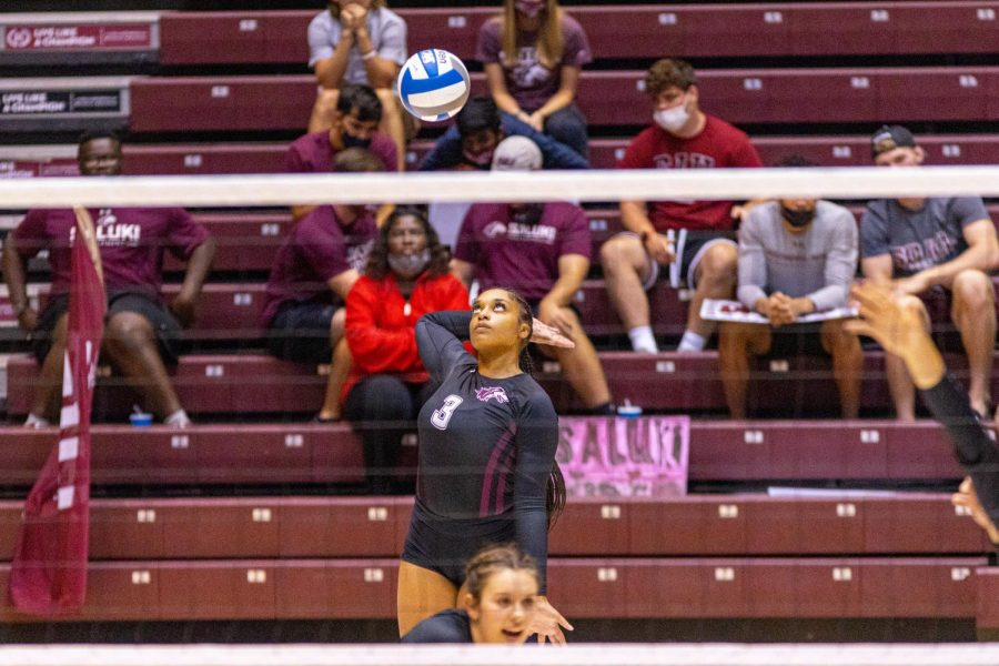 Alex Washington watches as the ball as she begins to bring her right arm back for the serve during the Salukis 3-0 win over the University of South Carolina - Upstate on Friday, Sept. 10, 2021 during the Saluki Invitational at the Banterra Center at SIU.