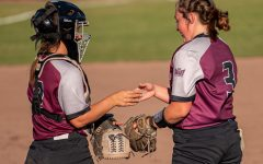 SIU catcher Sidney Sikes, left, does a special handshake with pitcher Madi Eberle during the 3-2 win against Murray State that went in extra innings on Sunday, Sept. 26, 2021 at the Charlotte West Stadium in Carbondale, Illinois.