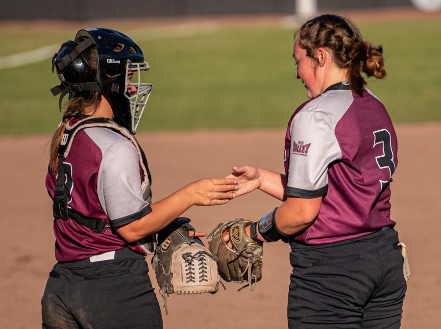 SIU+catcher+Sidney+Sikes%2C+left%2C+does+a+special+handshake+with+pitcher+Madi+Eberle+during+the+3-2+win+against+Murray+State+that+went+in+extra+innings+on+Sunday%2C+Sept.+26%2C+2021+at+the+Charlotte+West+Stadium+in+Carbondale%2C+Illinois.++++
