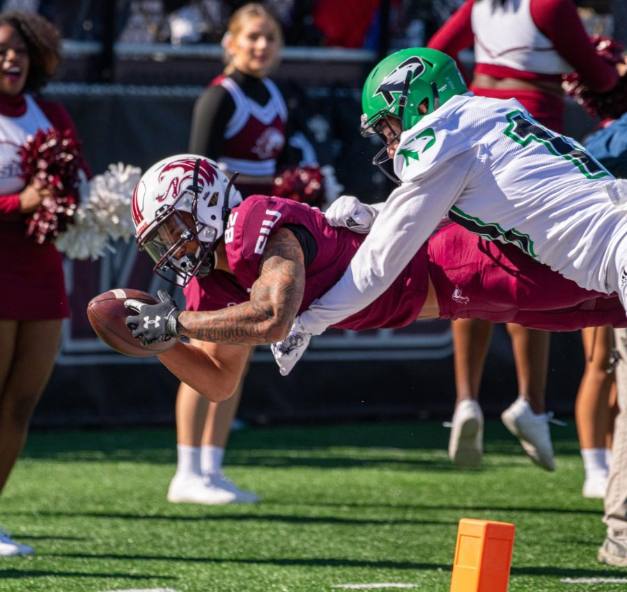Izaiah Hartrup dives towards the end zone. Hartrup would not score during the play, but the Salukis would later score during the drive during SIUs 31-28 win over North Dakota during the Homecoming game on Saturday, Oct. 16, 2021 at Salukis Stadium at SIU.