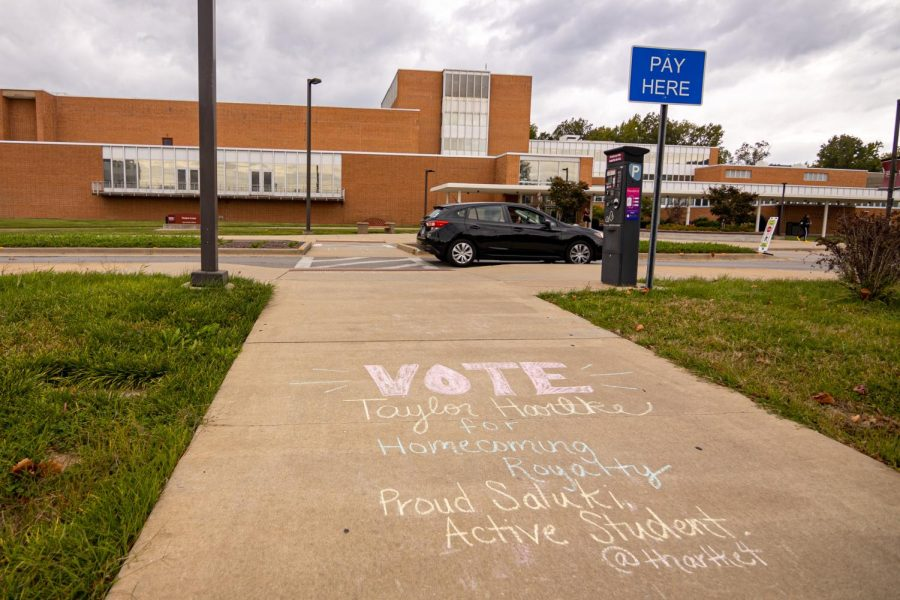 Outside the Student Center, a chalk endorsement of homecoming court member Taylor Hartke encouraging students to vote for her on Monday, Oct. 11, 2021 at SIU.