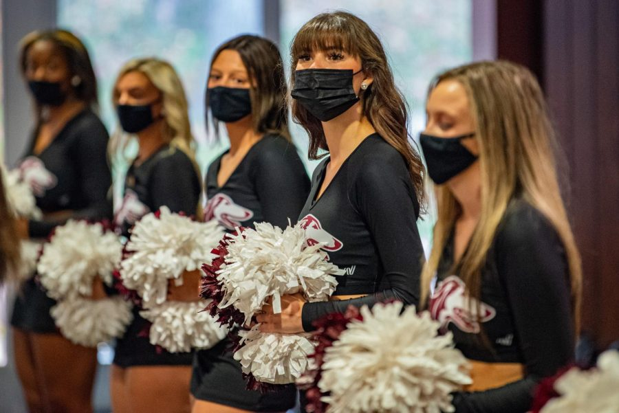 SIU shakers watch after their performance during the SIU Homecoming Pep Rally at the Student Center on Monday, Oct. 11, 2021 at SIU.
