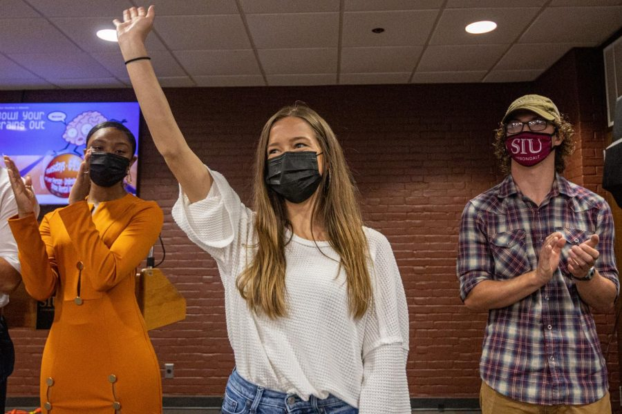 Chloe Leonard, middle, waves towards the crowd at the SIU Homecoming Pep Rally at the Student Center Monday, Oct. 11, 2021 at SIU.