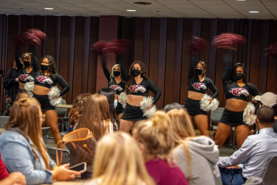 SIU Shakers perform in front of a crowd of people during the SIU Homecoming Pep Rally at the Student Center on Monday, Oct. 11, 2021 at SIU.