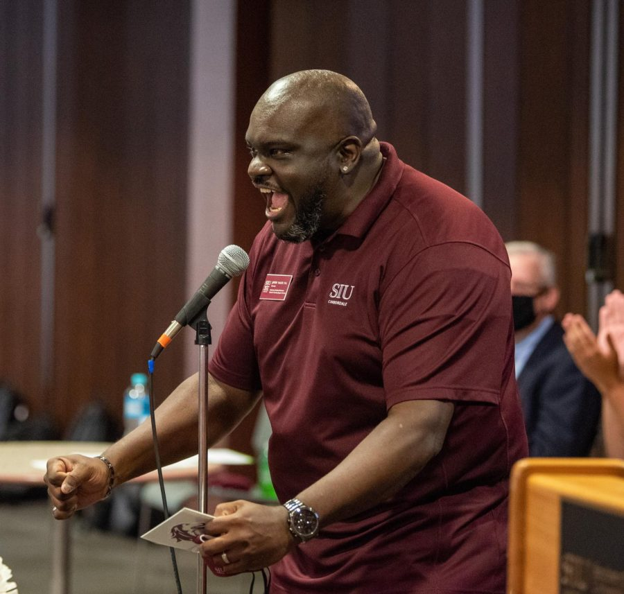 Announcer Jeffery McGoy yells to hype up the crowd during the SIU Homecoming Pep Rally at the Student Center on Monday, Oct. 11, 2021 at SIU.