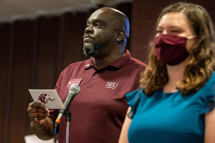 Announcer Jeffery McGoy looks upon the crowd while announcing the names of the Homecoming Court during the SIU Homecoming Pep Rally at the Student Center on Monday, Oct. 11, 2021 at SIU.