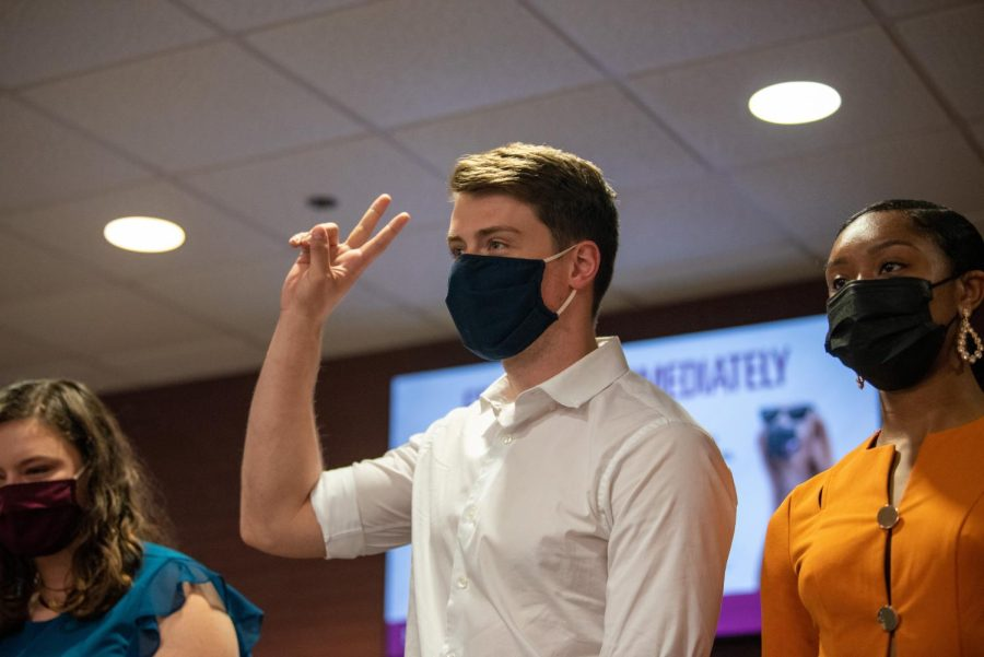 Brandon Goede throws up a peace sign after being introduced as apart of the SIU Homecoming Pep Rally at the Student Center Monday, Oct. 11, 2021 at SIU.