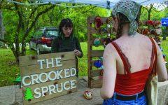"Savannah Bain buys small mushroom decor from Heather Hammers, owner of The Crooked Spruce and vendor at the Makanda Mushroom Festival Oct. 2, 2021 in Makanda, Ill. ""I'm really looking forward to the Tree ID hike,"" Bain said."