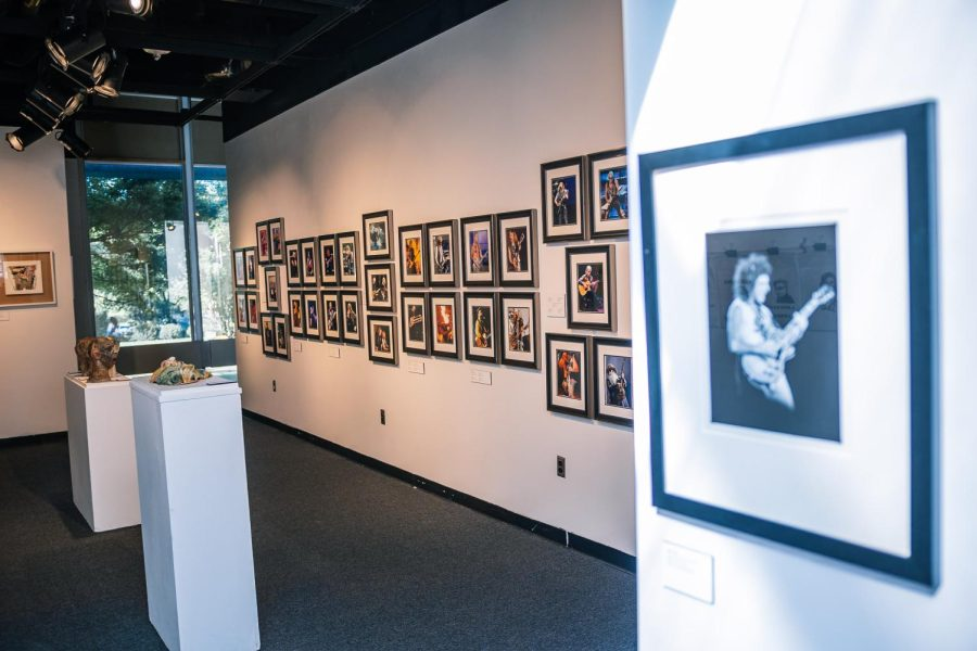 Photographs of famous rock and roll artists hang on the wall in the entryway to the University Museums Rocked and Rolled exhibit Oct. 16, 2021 at the University Museums North Hall in Carbondale, Ill.