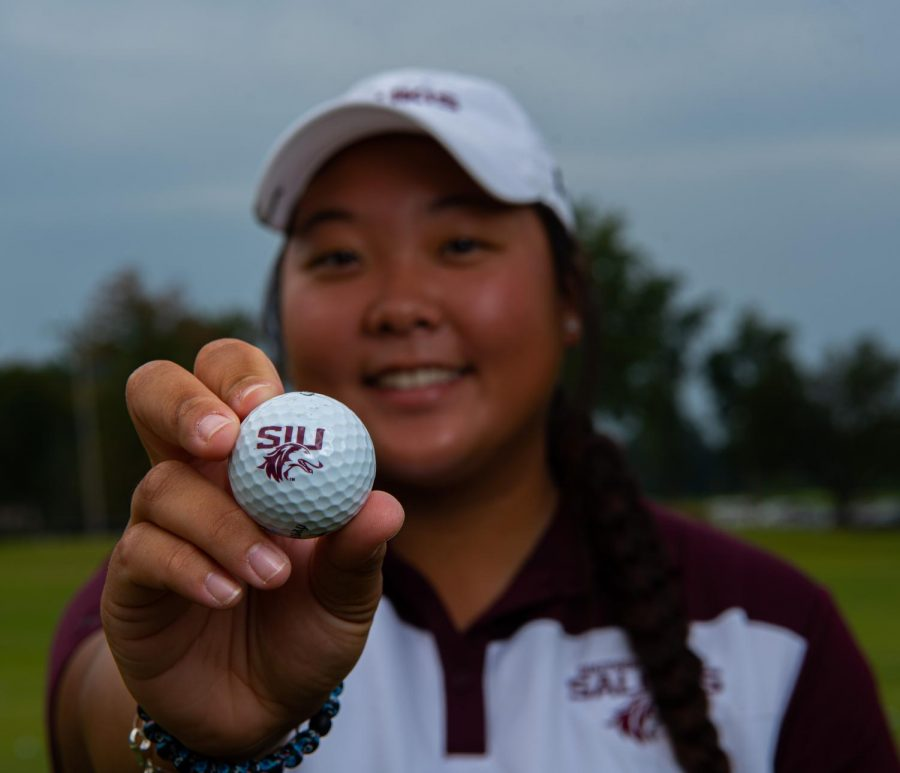 SIU golfball held by SIU golfer Moyea Russell on Friday, Oct. 1, 2021 at Hickory Ridge Public Golf Course in Carbondale, Illinois.